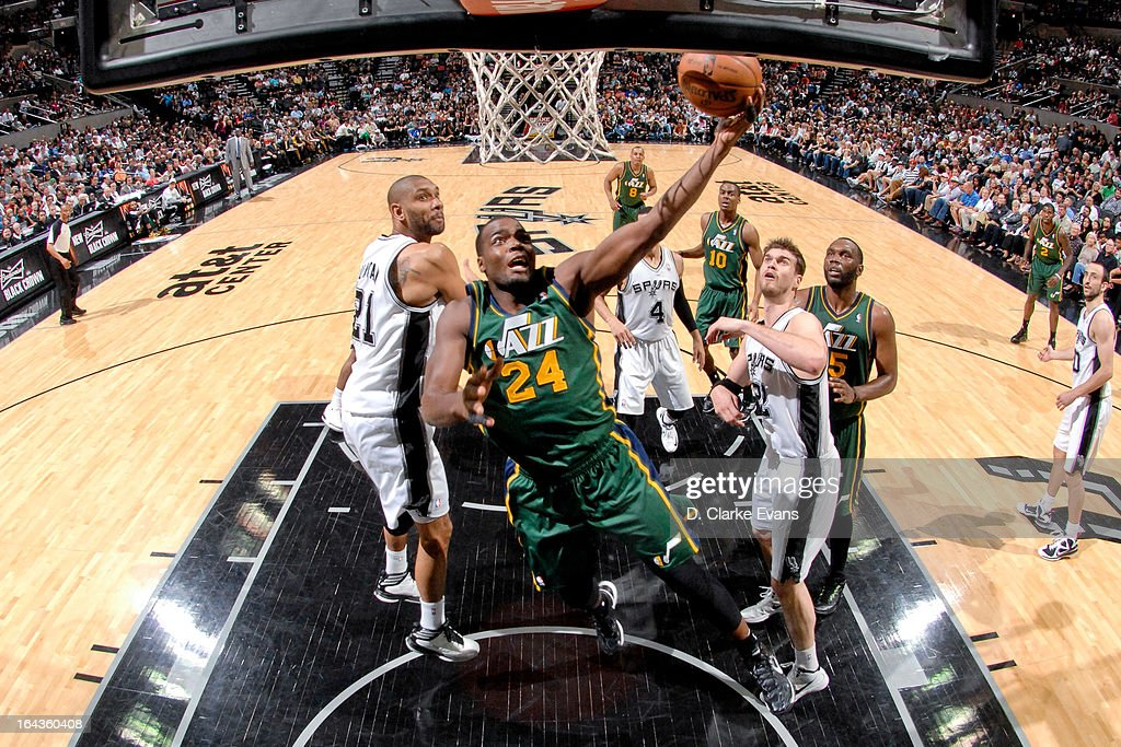 Paul Millsap #24 of the Utah Jazz shoots a layup against Tim Duncan #21 of the San Antonio Spurs on March 22, 2013 at the AT&T Center in San Antonio, Texas.