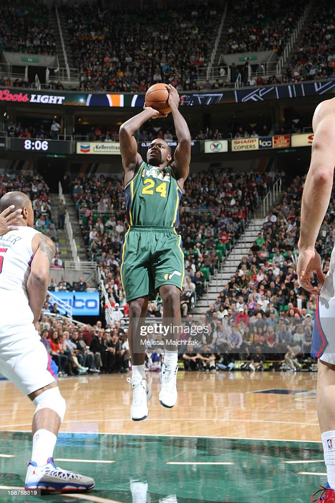 <a gi-track='captionPersonalityLinkClicked' href=/galleries/search?phrase=Paul+Millsap&family=editorial&specificpeople=880017 ng-click='$event.stopPropagation()'>Paul Millsap</a> #24 of the Utah Jazz shoots against <a gi-track='captionPersonalityLinkClicked' href=/galleries/search?phrase=Caron+Butler&family=editorial&specificpeople=201744 ng-click='$event.stopPropagation()'>Caron Butler</a> #5 of the Los Angeles Clippers at Energy Solutions Arena on December 28, 2012 in Salt Lake City, Utah.