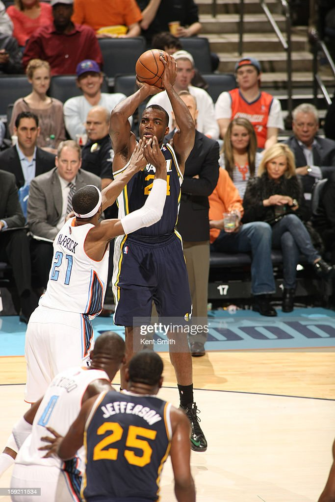 Paul Millsap #24 of the Utah Jazz shoots against Hakim Warrick #21 of the Charlotte Bobcats at the Time Warner Cable Arena on January 9, 2013 in Charlotte, North Carolina.
