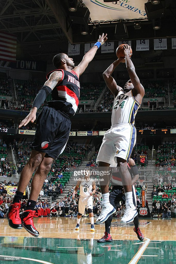 <a gi-track='captionPersonalityLinkClicked' href=/galleries/search?phrase=Paul+Millsap&family=editorial&specificpeople=880017 ng-click='$event.stopPropagation()'>Paul Millsap</a> #24 of the Utah Jazz shoots against <a gi-track='captionPersonalityLinkClicked' href=/galleries/search?phrase=LaMarcus+Aldridge&family=editorial&specificpeople=453277 ng-click='$event.stopPropagation()'>LaMarcus Aldridge</a> #12 of the Portland Trail Blazers at Energy Solutions Arena on February 01, 2013 in Salt Lake City, Utah.
