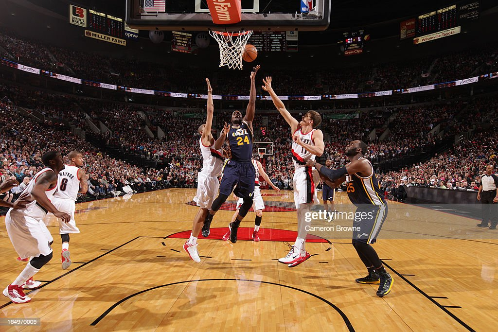 <a gi-track='captionPersonalityLinkClicked' href=/galleries/search?phrase=Paul+Millsap&family=editorial&specificpeople=880017 ng-click='$event.stopPropagation()'>Paul Millsap</a> #24 of the Utah Jazz shoots against <a gi-track='captionPersonalityLinkClicked' href=/galleries/search?phrase=Nicolas+Batum&family=editorial&specificpeople=3746275 ng-click='$event.stopPropagation()'>Nicolas Batum</a> #88 and <a gi-track='captionPersonalityLinkClicked' href=/galleries/search?phrase=Meyers+Leonard&family=editorial&specificpeople=6893999 ng-click='$event.stopPropagation()'>Meyers Leonard</a> #11 of the Portland Trail Blazers on March 29, 2013 at the Rose Garden Arena in Portland, Oregon.