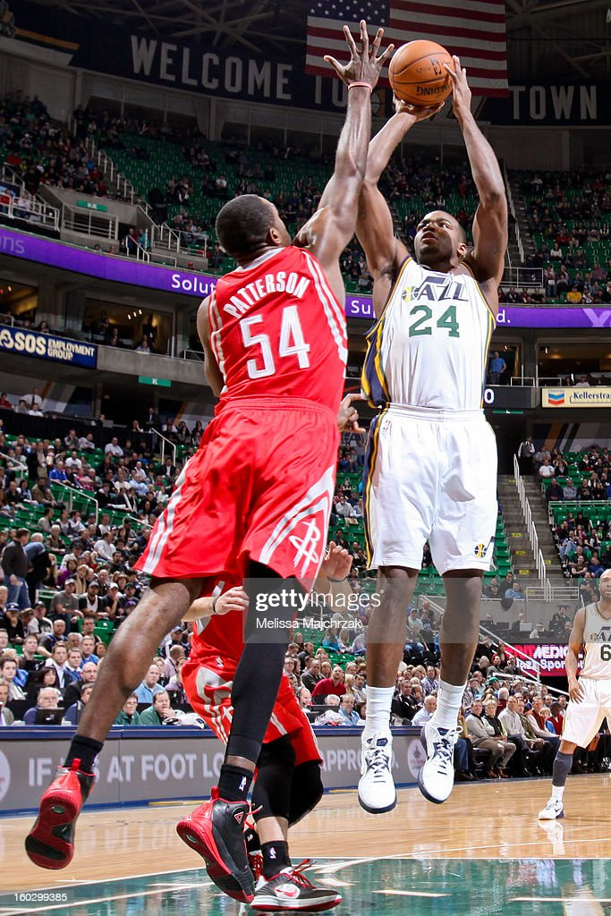 Paul Millsap #24 of the Utah Jazz shoots against Patrick Patterson #54 of the Houston Rockets at Energy Solutions Arena on January 28, 2013 in Salt Lake City, Utah.