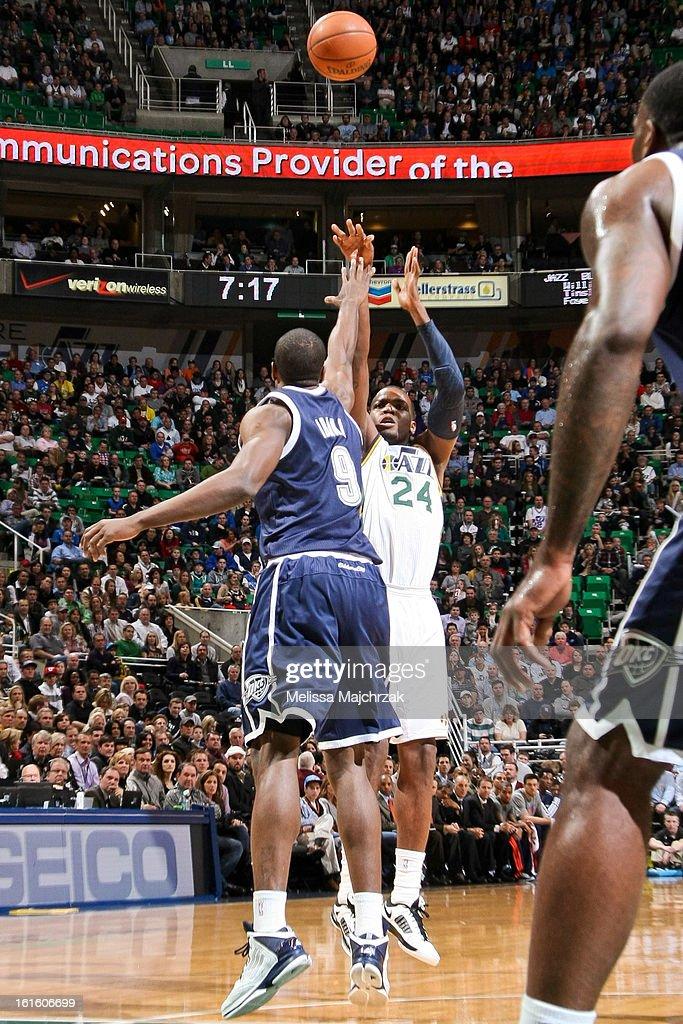 Paul Millsap #24 of the Utah Jazz shoots against Serge Ibaka #9 of the Oklahoma City Thunder at Energy Solutions Arena on February 12, 2013 in Salt Lake City, Utah.