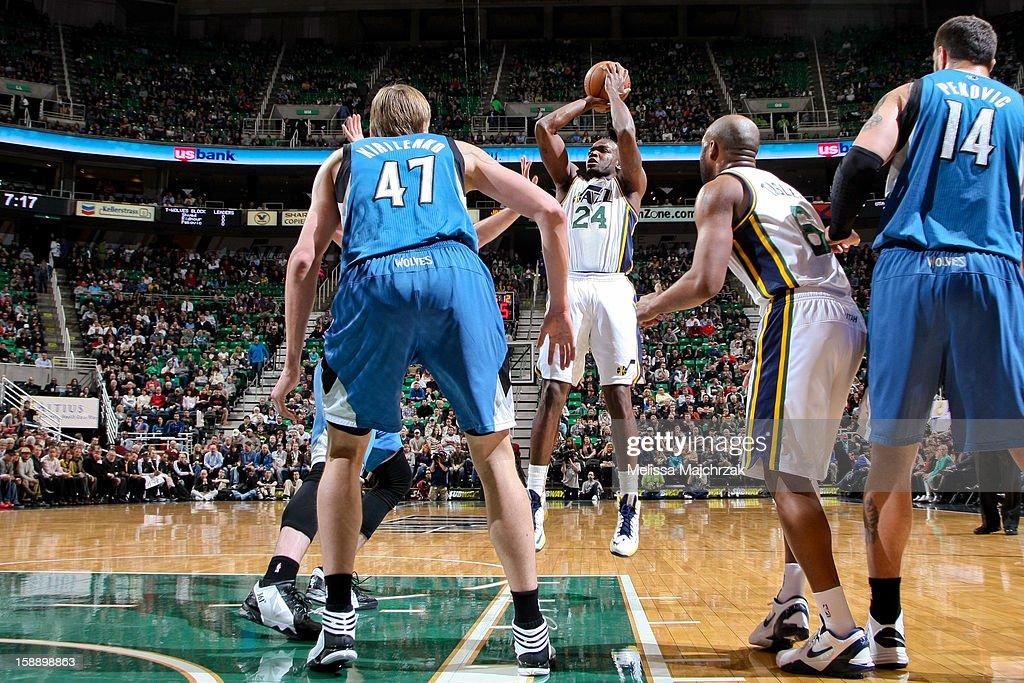 Paul Millsap #24 of the Utah Jazz shoots against the Minnesota Timberwolves at Energy Solutions Arena on January 2, 2013 in Salt Lake City, Utah.