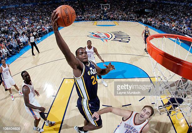 Paul Millsap of the Utah Jazz shoots over Nenad Krstic of the Oklahoma City Thunder on October 31 2010 at the Ford Center in Oklahoma City Oklahoma...