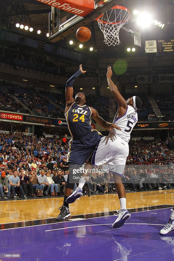Paul Millsap #24 of the Utah Jazz shoots the ball against DeMarcus Cousins #15 of the Sacramento Kings on November 24, 2012 at Sleep Train Arena in Sacramento, California.