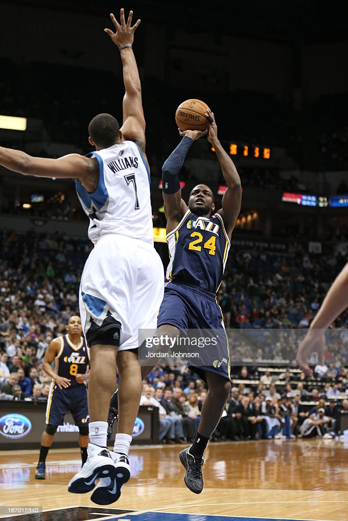 <a gi-track='captionPersonalityLinkClicked' href=/galleries/search?phrase=Paul+Millsap&family=editorial&specificpeople=880017 ng-click='$event.stopPropagation()'>Paul Millsap</a> #24 of the Utah Jazz shoots the ball against the Minnesota Timberwolves on April 15, 2013 at Target Center in Minneapolis, Minnesota.