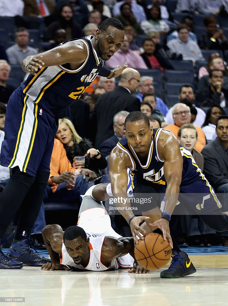 Paul Millsap #24 of the Utah Jazz watches as teammate DeMarre Carroll #3 goes after a loose ball against Ben Gordon #8 of the Charlotte Bobcats during their game at Time Warner Cable Arena on January 9, 2013 in Charlotte, North Carolina.