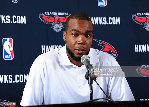 Paul Millsap speaks to the media as he is introduced as the newest member of the Atlanta Hawks during a press conference on July 10 2013 at Philips...