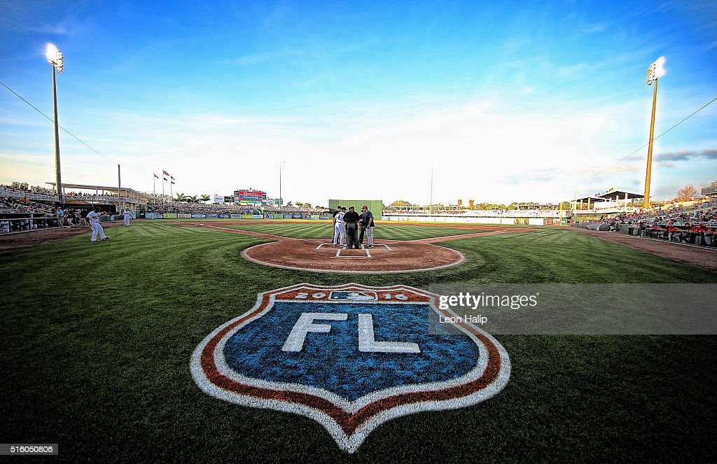 Paul Molitor of the Minnesota Twins and John Farrell of the Boston Red Sox meet at home plate prior to the start of the Spring Training Game on March...