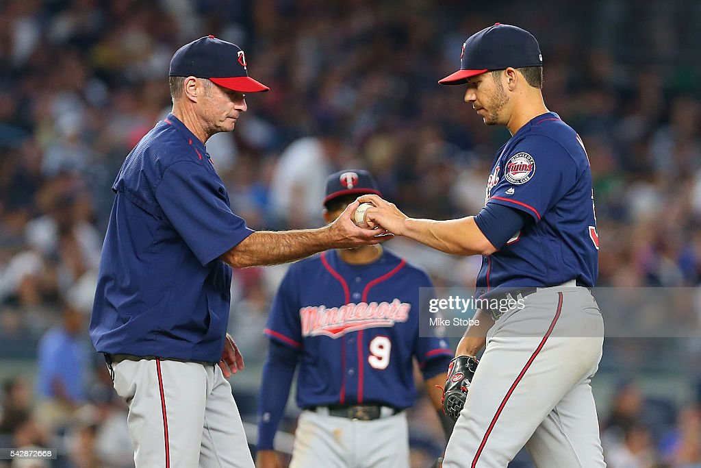 <a gi-track='captionPersonalityLinkClicked' href=/galleries/search?phrase=Paul+Molitor&family=editorial&specificpeople=209261 ng-click='$event.stopPropagation()'>Paul Molitor</a> #4 of the Minnesota Twins removes <a gi-track='captionPersonalityLinkClicked' href=/galleries/search?phrase=Tommy+Milone&family=editorial&specificpeople=8240408 ng-click='$event.stopPropagation()'>Tommy Milone</a> #33 in the fourth inning against the New York Yankees at Yankee Stadium on June 24, 2016 in the Bronx borough of New York City. Boston