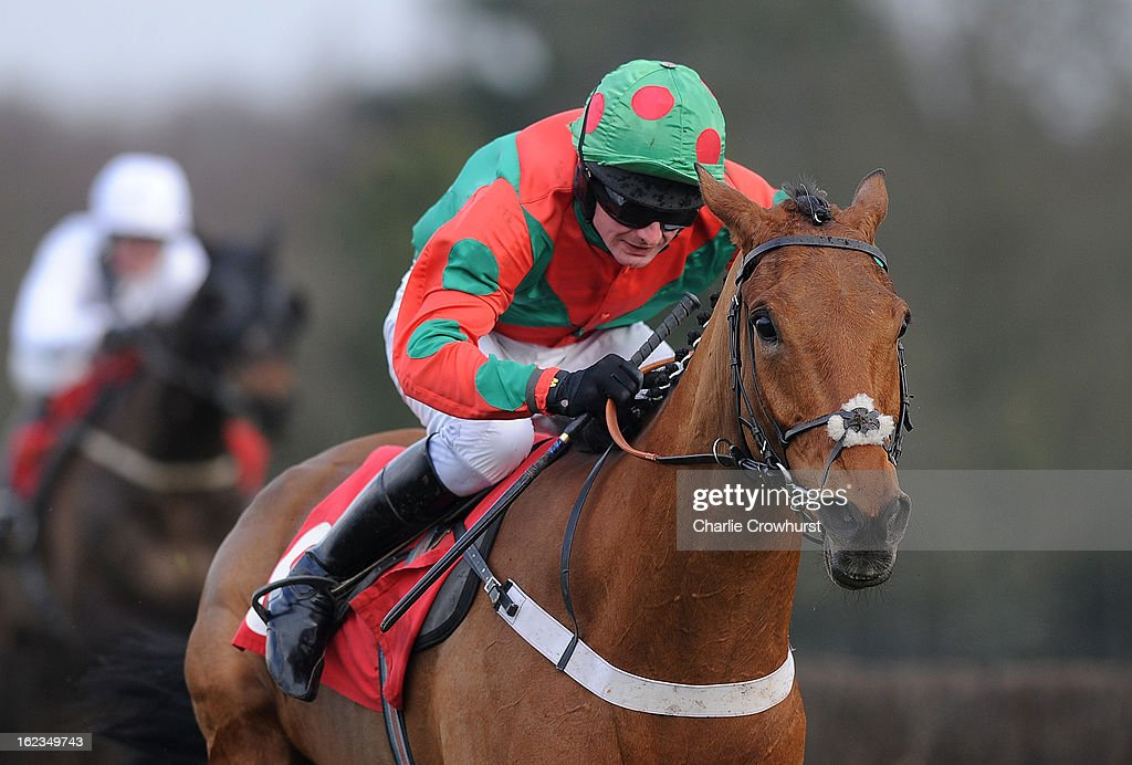 Paul Moloney rides Olympian Boy to the win in The John Ratcliffe Retirement Hadicap Steeple Chase at Sandown Park racecourse on February 22, 2013 in Esher, England.