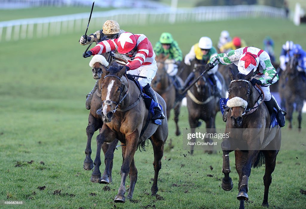 Paul Moloney riding Mountainous (R) clear the last to win The Coral Welsh Grand National from Hawkes Point (C) at Chepstow racecourse on December 28, 2013 in Chepstow, Wales.