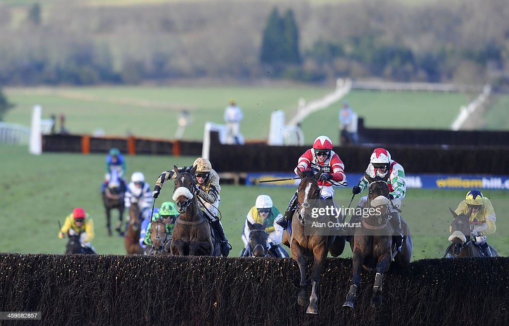 Paul Moloney riding Mountainous (2R) clear the last to win The Coral Welsh Grand National from Hawkes Point (3R) at Chepstow racecourse on December 28, 2013 in Chepstow, Wales.