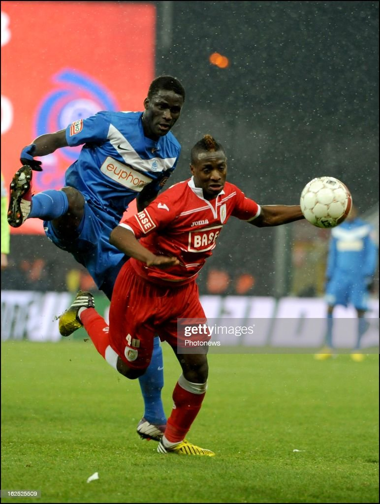 Paul Mpoku of Standard Liege and Kara Mbodji Serigne of KRC Genk in action during the Jupiler League match between Standard de Liege and KRC Genk on February 24, 2013 in Liege, Belgium.