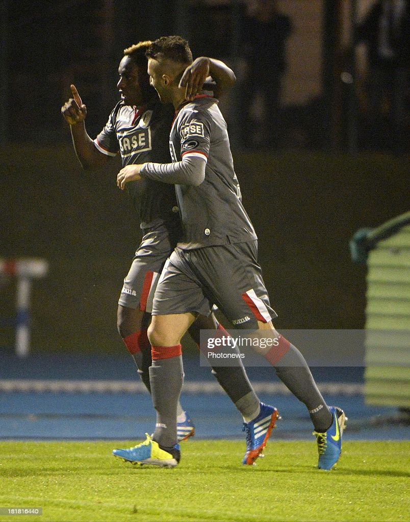 Paul Mpoku of Standard Liege celebrates with teammates after scoring during the Cofidis Cup match between White Star and Standard of Liege on september 25 , 2013 in Woluwe, Belgium.