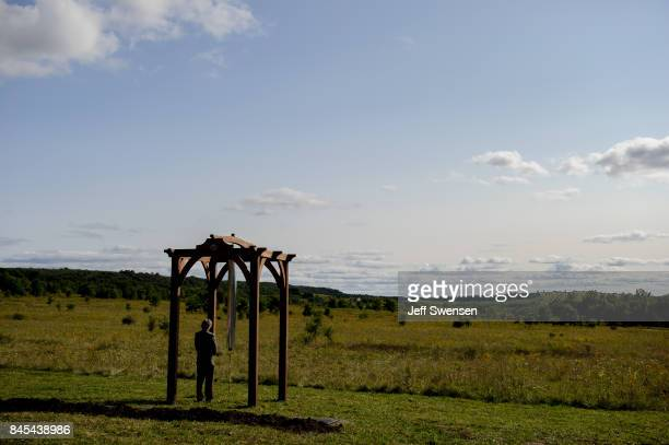 Paul Murdoch architect of the Flight 93 National Memorial rings a sample chime at the groundbreaking of the Tower Of Voices at the Flight 93 National...