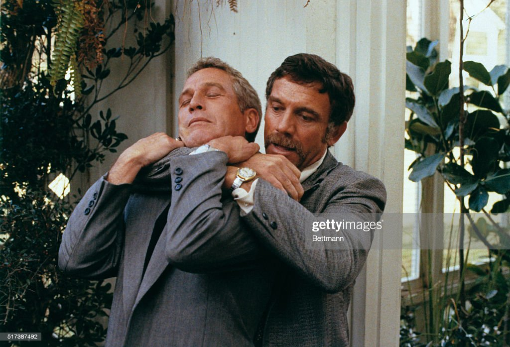 Paul Newman as Harper is hammerlocked by Tony Franciosa who portrays a southern police chief Broussard in the film The Drowning Pool filmed on...