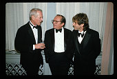 Paul Newman talks with director Sidney Lumet and Al Pacino at a party