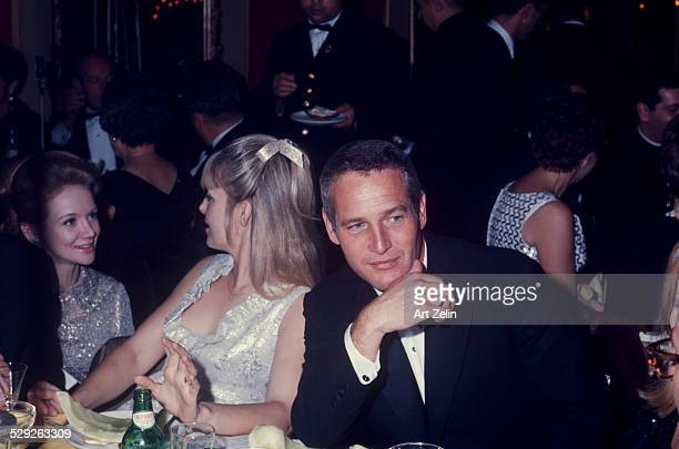 Paul Newman with is wife Joanne Woodward at a formal dinner circa 1970 New York
