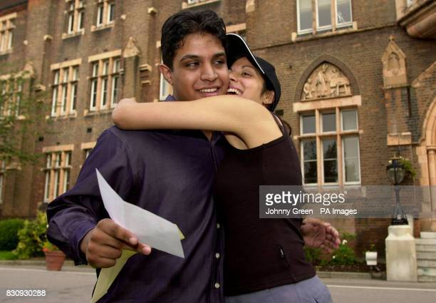 Paul Nicholas is congratulated by his friend Ruth de Souza after opening his ALevel exam results to find five grade 'A's' outside their school St...