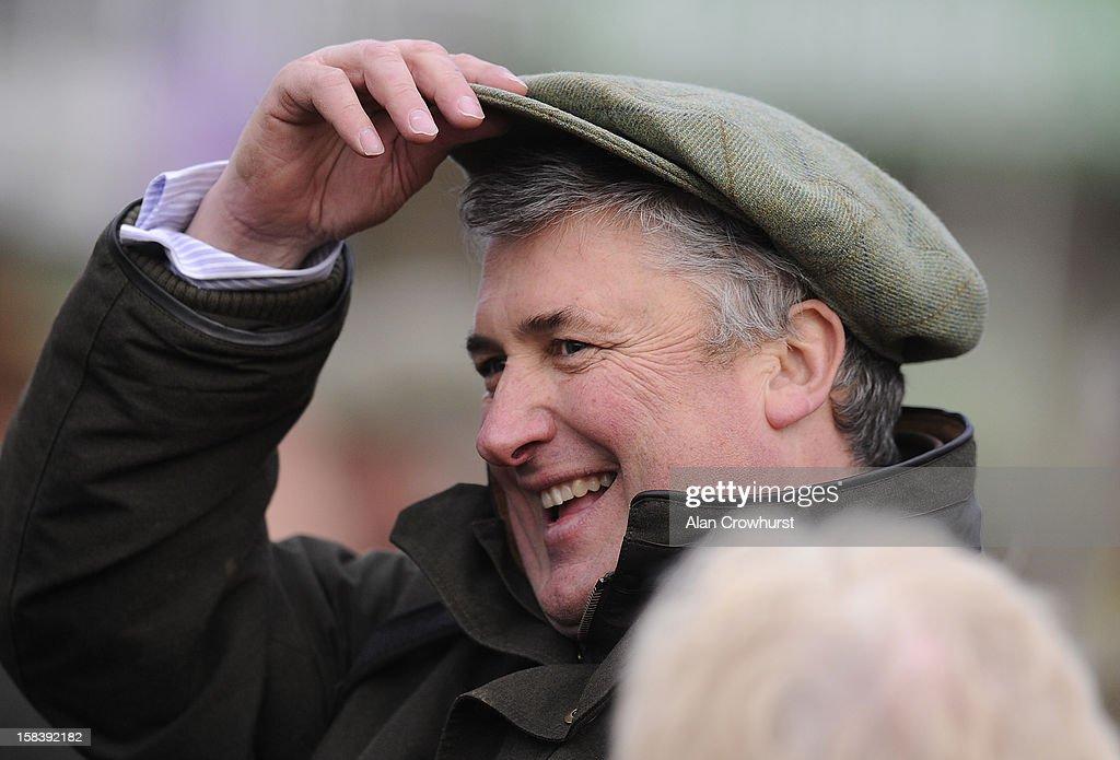 Paul Nicholls celebrates having four winners on the day at Cheltenham racecourse on December 15, 2012 in Cheltenham, England.
