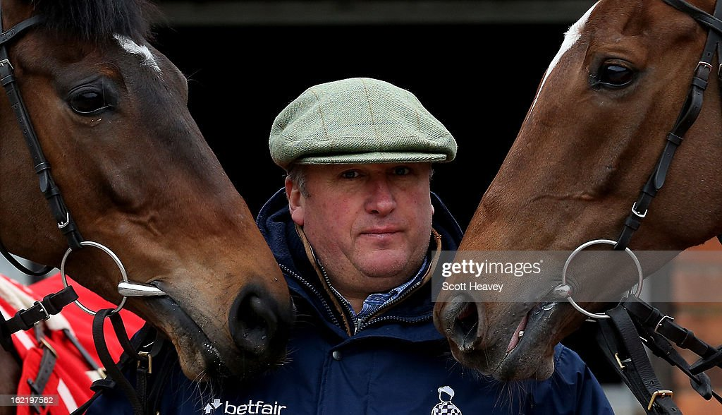 Paul Nicholls with Zarkander (L) and Silviniaco Conti during a stable visit to Manor Farm Stables on February 20, 2013 in Shepton Mallet, England.