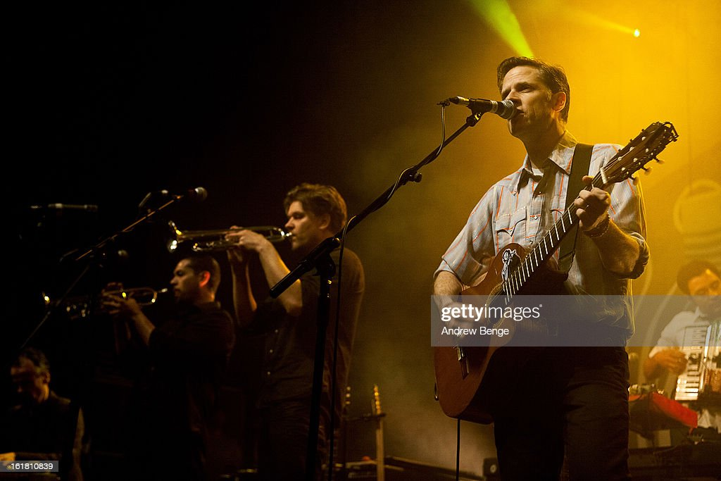 Paul Niehaus, Jacob Valenzuela and Joey Burns of Calexico perform on stage at HMV Ritz on February 16, 2013 in Manchester, England.
