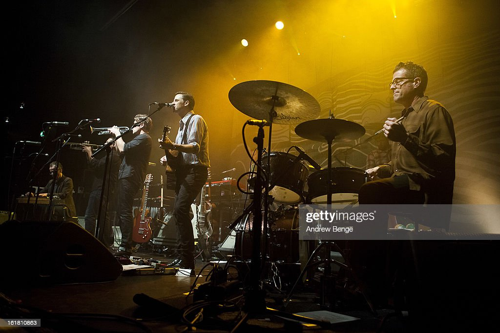 Paul Niehaus, Jacob Valenzuela, Joey Burns and John Convertino of Calexico perform on stage at HMV Ritz on February 16, 2013 in Manchester, England.