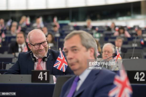 Paul Nuttall leader of the UK Independence Party left reacts as he sits behind Nigel Farage member of European Parliament and former leader of the UK...