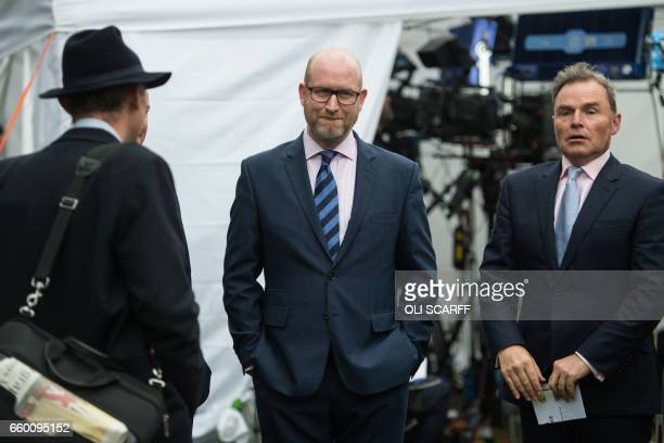 Paul Nuttall the leader of the antiEU UK Independence Party waits to be interviewed near the Houses of Parliament in London on March 29 shortly...