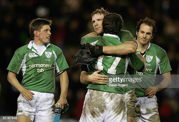 Paul O'Connell hugs Marcus Horan as Ronan O'Gara and Girvan Dempsey watch on after the final whistle of the RBS Six Nations International between...