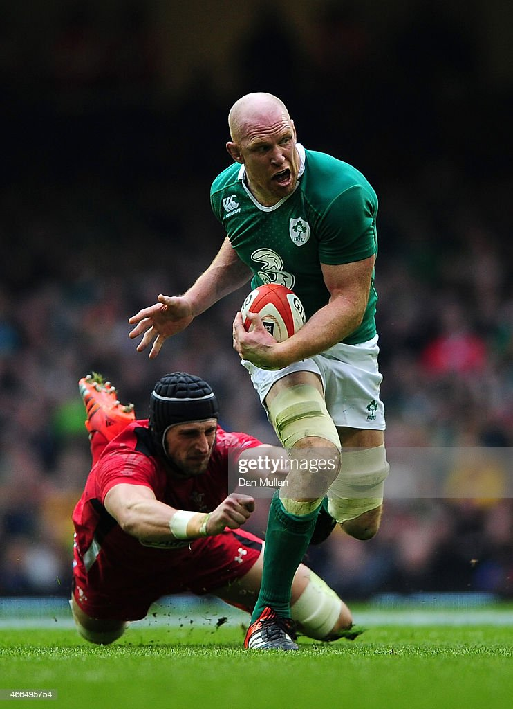 Paul O'Connell of Ireland is tackled by Luke Charteris of Wales during the RBS Six Nations match between Wales and Ireland at Millennium Stadium on...