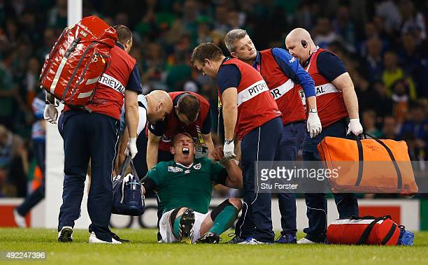 Paul O'Connell of Ireland reacts as he receives medical treatment during the 2015 Rugby World Cup Pool D match between France and Ireland at...