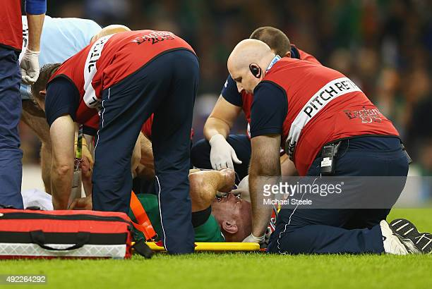 Paul O'Connell of Ireland receives medical treatment during the 2015 Rugby World Cup Pool D match between France and Ireland at Millennium Stadium on...