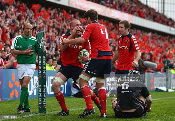 Paul O'Connell of Munster celebrates his try with Donncha O'Callaghan during the Heineken Cup Quarter Final match between Munster and Ospreys at...