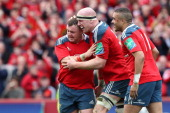 Paul O'Connell of Munster is congratulated by Dave Kilcoyne and Simon Zebo after scoring the last try for Munster during the Heineken Cup Quarter...