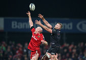 Paul O'Connell of Munster jumps for the ball against George Kruis during the European Rugby Champions Cup match between Munster and Saracens at...
