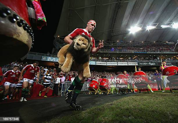 Paul O'Connell the Lions match captain leads out the team out during the match between the British Irish Lions and the Barbarians at Hong Kong...