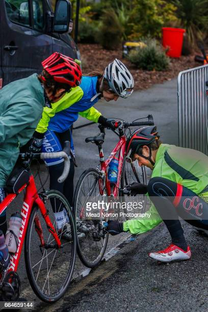 Paul Odlin showing a few riders how to properly apply oil to a chain before the start of stage 5 of the Tour of New Zealand on April 5 2017 in...
