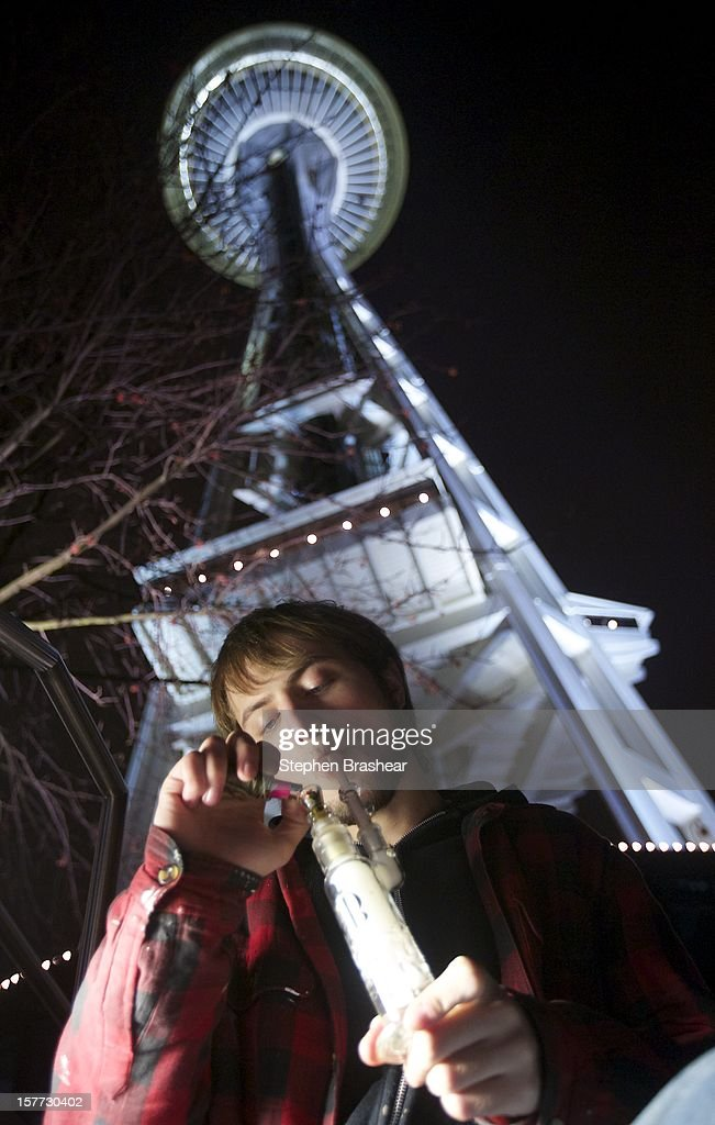 Paul of Tacoma, who declined to give his last name smokes marijuana from a water pipe underneath the Space Needle shortly after a law legalizing the recreational use of marijuana took effect on December 6, 2012 in Seattle, Washington. Voters approved an initiative to decriminalize the recreational use of marijuana making it one of the first states to do so.