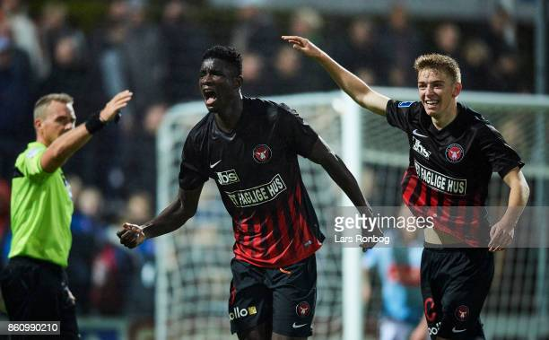 Paul Onuachu and Andreas Poulsen of FC Midtjylland celebrate after scoring their first goal during the Danish Alka Superliga match between...
