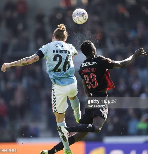 Paul Onuachu of FC Midtjylland and Pierre Kanstrup of SonderjyskE compete for the ball during the Danish Alka Superliga match between FC Midtjylland...