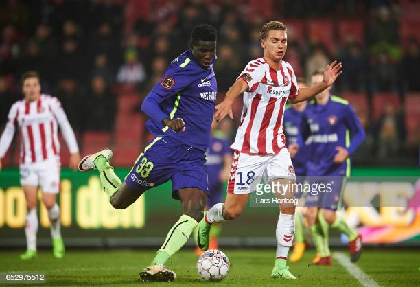 Paul Onuachu of FC Midtjylland and Rasmus Thellufsen of AaB Aalborg compete for the ball during the Danish Alka Superliga match between AaB Aalborg...