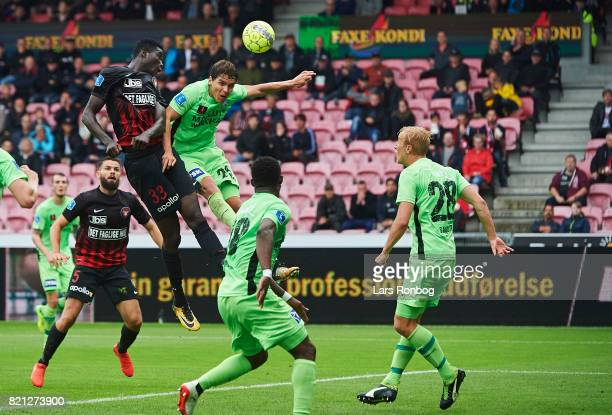 Paul Onuachu of FC Midtjylland and Robert Skov of Silkeborg IF compete for the ball during the Danish Alka Superliga match between FC Midtjylland and...