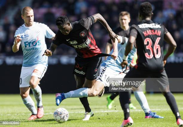 Paul Onuachu of FC Midtjylland and Sakari Mattila of SonderjyskE compete for the ball during the Danish Alka Superliga match between FC Midtjylland...