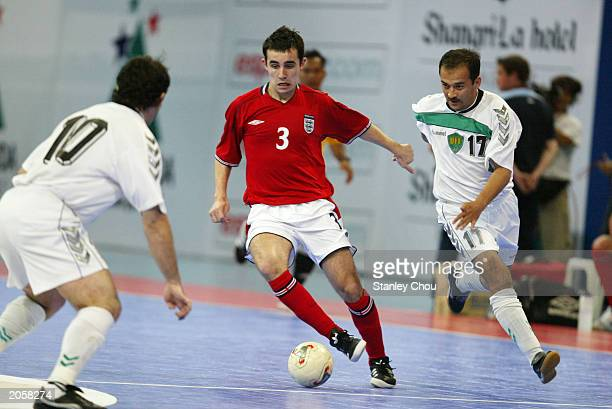 Paul Osborne of England tries to get past Nurmatov Nigman and Abduraimov Azamat of Uzbekistan during the 2003 World 5s Futsal Championship between...