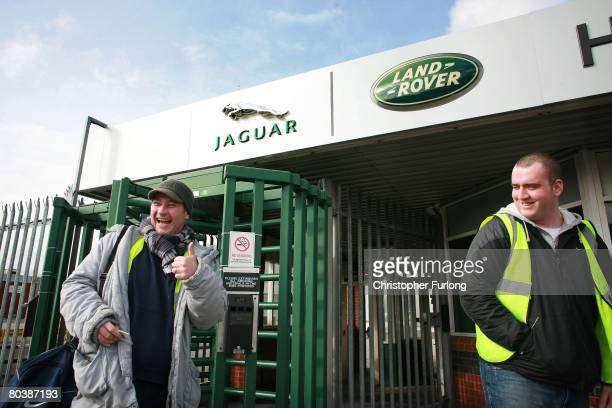Paul Owens and fellow shift worker leaving the Halewood operations site of Jaguar and Land Rover in Merseyside show their delight at the news that...