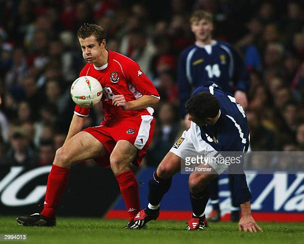 Paul Parry of Wales avoids Graeme Murty of Scotland during the International Friendly match between Wales and Scotland at The Millennium Stadium on...