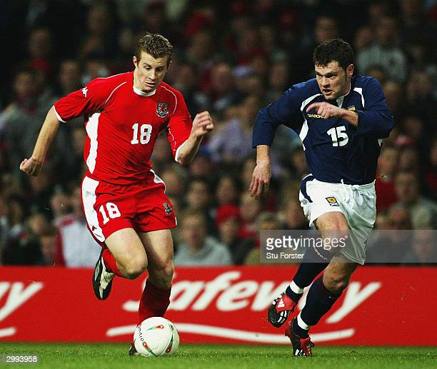 Paul Parry of Wales is put under pressure by Graeme Murty of Scotland during the International Friendly match between Wales and Scotland at The...